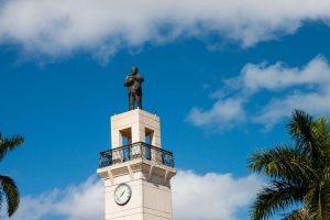 Addison Mizner at top of Royal Palm Plaza Bldg
